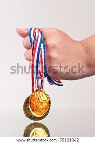 Girl Clutching Victory Gold Medals