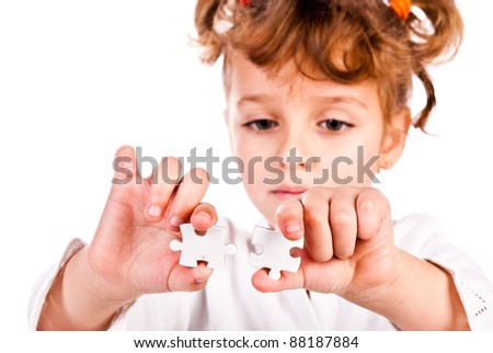 girl collect puzzle isolated on a white background