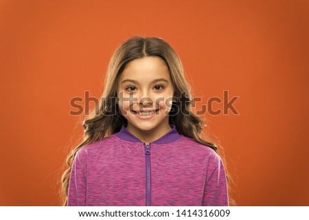 Girl cute child happy smiling face. Child long hair happy smiling. Happy childhood concept. What science has to say about genuine and fake smiles. What is difference between phony and sincere smile.