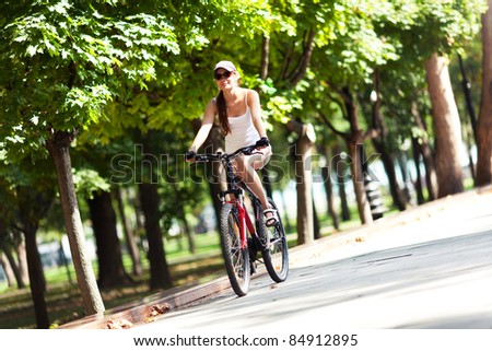 Girl cycling in the park.