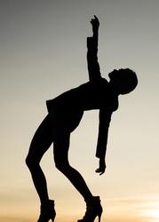 Girl dancer dancing silhouette evening sky, woman