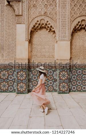 Girl dancing in Ben Youssef Madrasa in marrakesh in morocco
