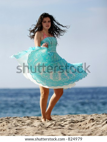 Girl dancing on the beach