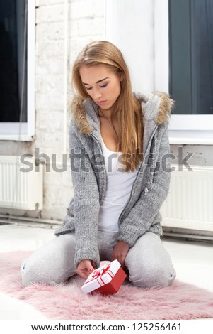 Girl deciding if she should accept gift