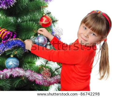 Girl decorates a fur-tree. Isolated on the white - stock photo
