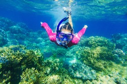Girl dives in a tropical sea