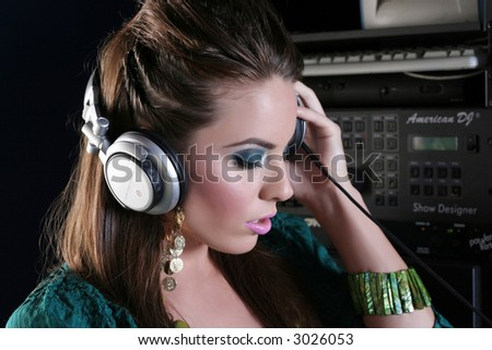 Girl DJ in the sound room