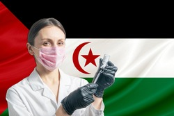 Girl doctor prepares vaccination against the background of the Western Sahara flag. Vaccination concept Western Sahara.