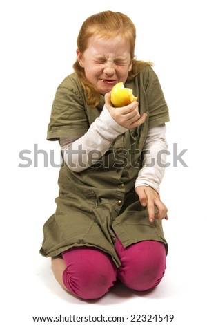 girl does not like the apple she is eating on white