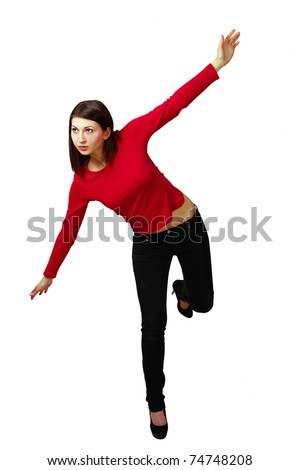 Girl doing a balancing act - stock photo