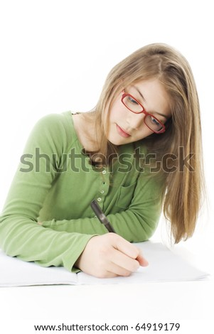 Girl doing homework. Isolated on white