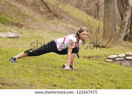 Girl doing morning exercises in the park