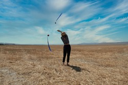 Girl doing poi on a field