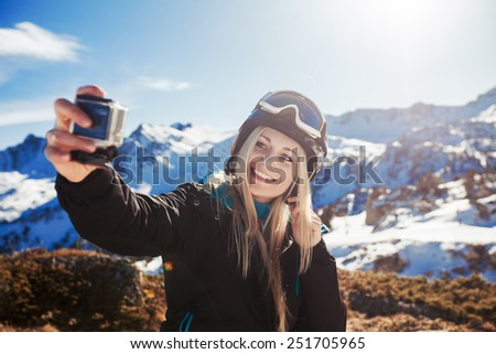 girl doing selfie mountains in the background