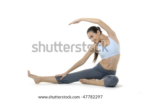 Girl doing yoga on white