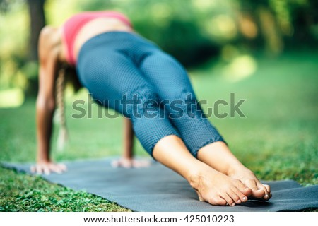 Girl doing Yoga, Reverse Plank Pose or Purvottanasana