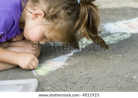 girl drawing on the asphalt