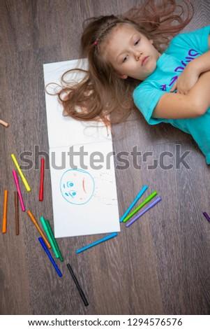 girl draws sadness