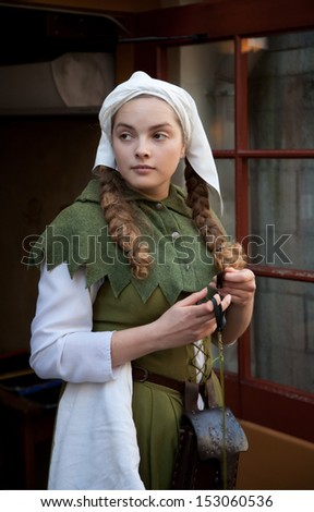 Girl dressed in medieval dress
