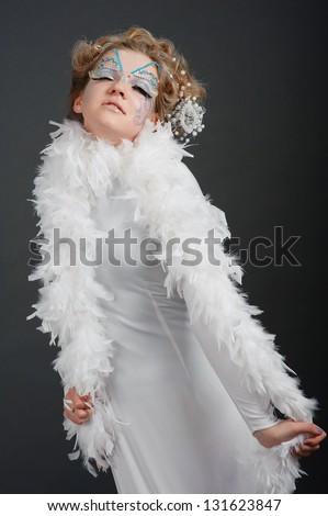 girl dressed in white fluffy hair