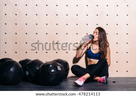 Girl drinking water at the gym #478214113