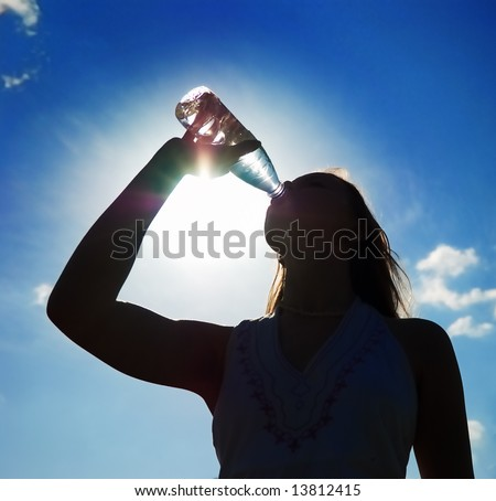 girl drinking water outdoor silhouette