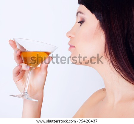 Girl drinking wine in studio - stock photo