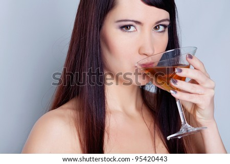 Girl drinking wine in studio