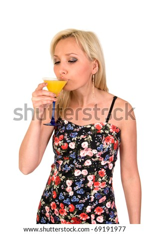 Girl drinks cocktail from glass isolated on white background.