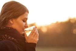 girl drinks tea in autumn