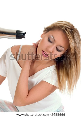 Girl drying her hair with air-blower