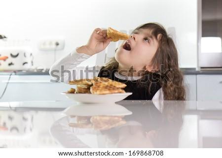 Girl eating waffles