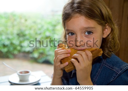 girl eats a sandwich with gusto #64559905