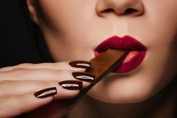girl eats chocolate