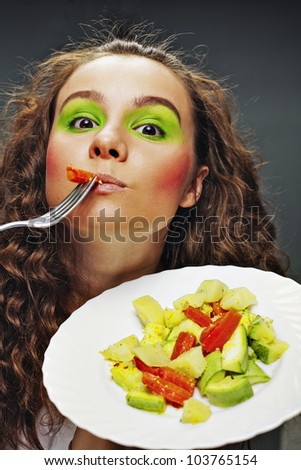 Girl eats green vegetables