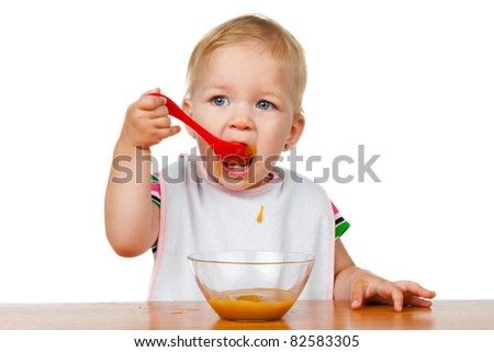 girl eats with a spoon