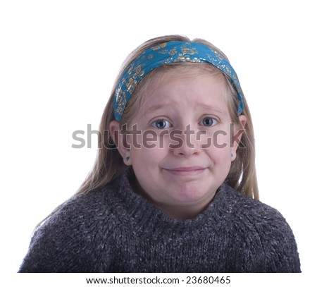 Girl embarrassed in a gray sweater on a white background