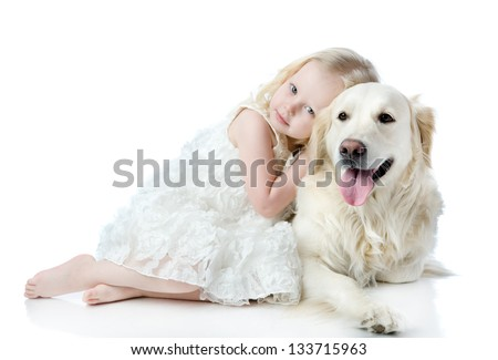 girl embraces a Golden Retriever. looking at camera. isolated on white background