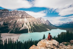 Girl enjoy a beautiful mountain lake. Peyto Lake, Canadian Rockies, Alberta, Canada