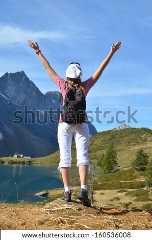 Girl enjoying Alpine panorama. Switzerland