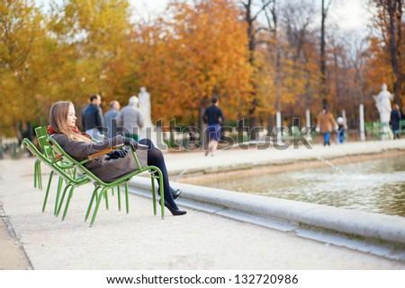 Girl enjoying beautiful autumn day in a park