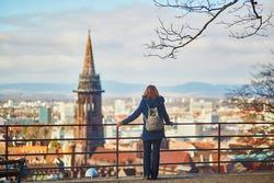 Girl enjoying beautiful panorama of Freiburg im Breisgau in Germany