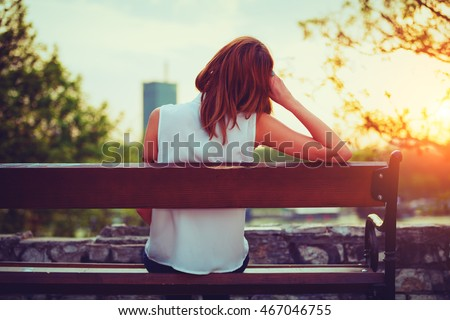 girl enjoying city view from a...