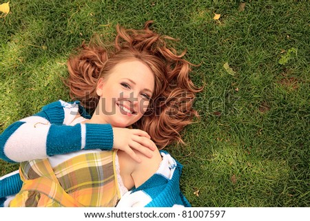 Girl enjoying laying in the grass