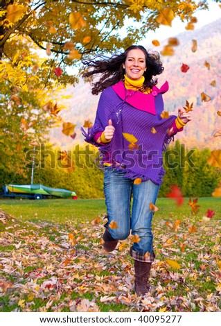 girl enjoying leisure in a park on a autumn-day