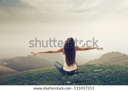Girl enjoying the freedom in a wasteland