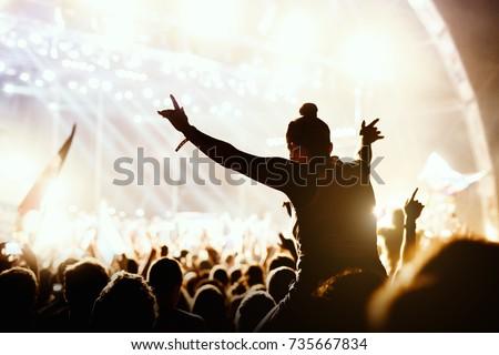 Girl enjoying the outdoor music festival concert.