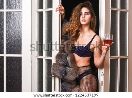 Girl enter bedroom doors. Fashion lady enjoy her seductiveness. Woman seductive appearance. Confident in her magnetism. Woman seductive model wear luxury fur and elite lingerie. Seduction art concept.