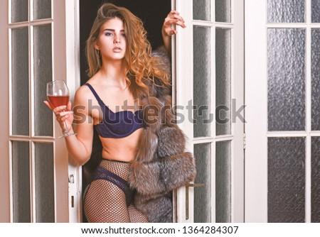 Girl enter bedroom doors. Fashion lady enjoy her seductiveness. Woman seductive appearance. Confident in her magnetism. Woman seductive model wear luxury fur and elite lingerie. Seduction art concept.