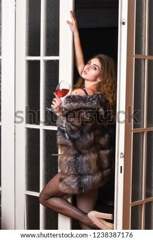 Girl enter bedroom doors. Fashion lady enjoy her seductiveness. Woman seductive appearance. Woman seductive model wear luxury fur and elite lingerie. Confident in her magnetism. Seduction art concept.